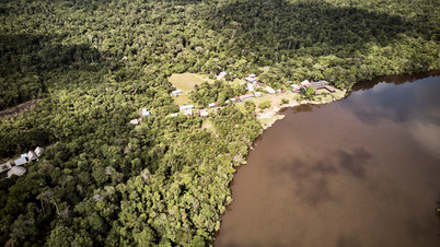 The Mishana Community - With Chamisal Retreat Center on the left - Banks of the Nanay River - Drone shot Amazon Rainforest