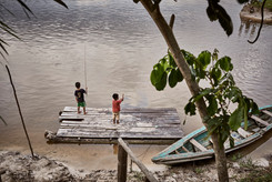 Local Mishana Children Fishing in the Nanay River - Perfect for Swimming on Our Ayahuasca Retreats - Casa Galactica