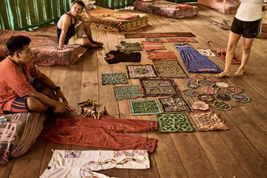 Shipibo Curandero Urias Selling Shipibo Fabrics at 2 Week Ayahuasca Plant Spirit Healing Retreat