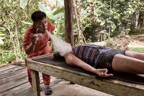Curandero Urias Using Mapacho to Clear the Energy of a Participant Following a Shipibo Plant Sauna - Ayahuasca Retreats Peru