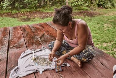 Angela Making Shipibo Handcrafts, Fabrics and Art at Chamisal Retreat Center - Casa Galactica