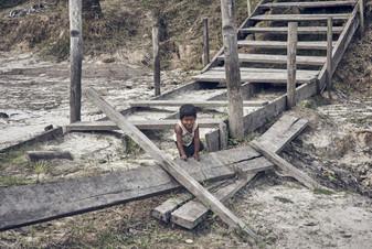 Young boy on the Banks of the Mishana Community - Casa Galactica - Ayahausca Retreats & Noya Rao Dietas