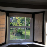 Three blinds in a splay bay with contrast borders