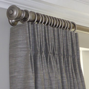 Double pinch pleat headed curtains on chunky wooden poles