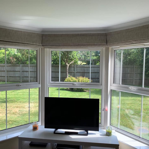 A trio of blinds in a splay bay