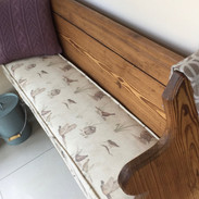 Piped bench seat pad
