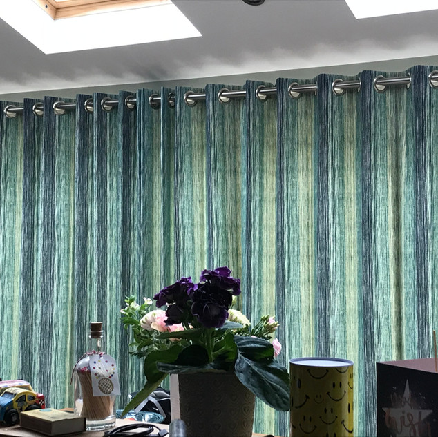 Eyelet headed curtains on chunky metal pole