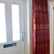 Single door curtain with pinch pleat heading