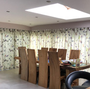 A pair of wave headed curtains fitted inside the recess