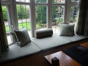 Recovered window seat pads