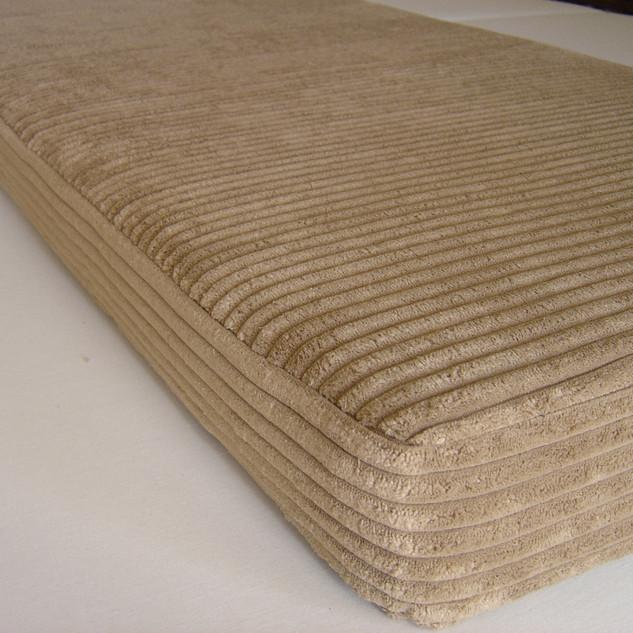 Unpiped seat cushion in jumbo cord fabric