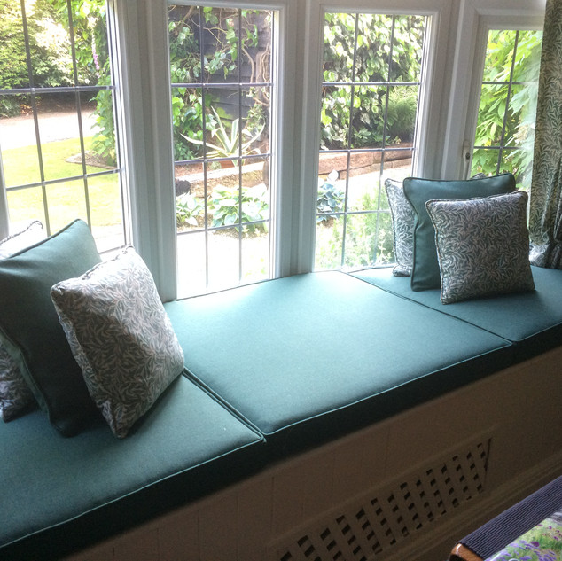 Recovered window seat cushions