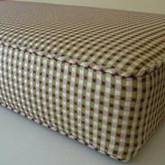 Piped cushion pad