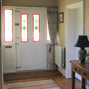 Single curtain with pinch pleat heading on a pole with recess brackets