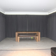 Three pairs of pinch pleat headed curtains on bespoke poles - closed