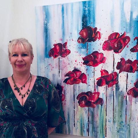 Jay Nolan-Latchford the artist next to hr original art Poppies