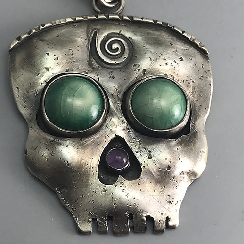 SkullPendant with Pottery Eyes