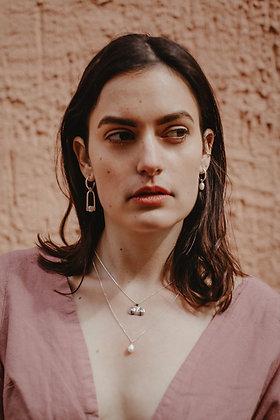 Asymetric pearls earrings