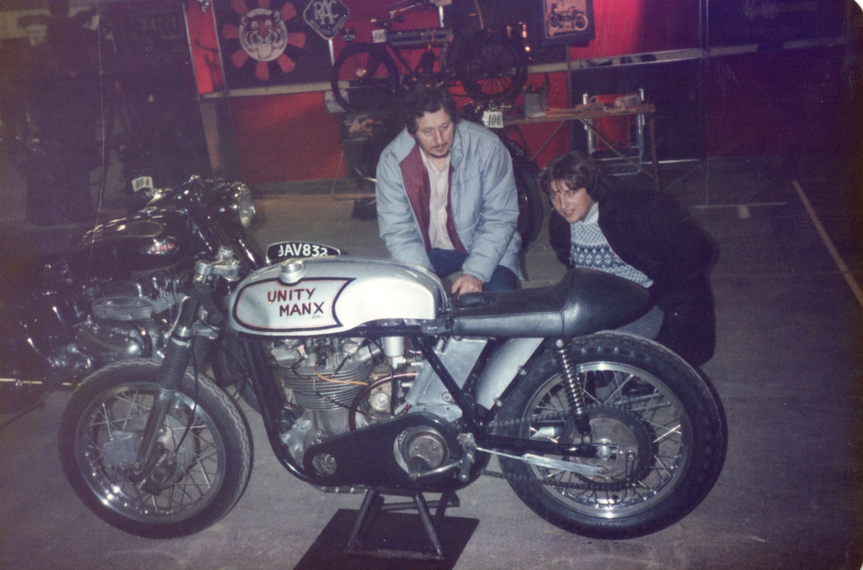 Two men looking at Pete's Unity Manx