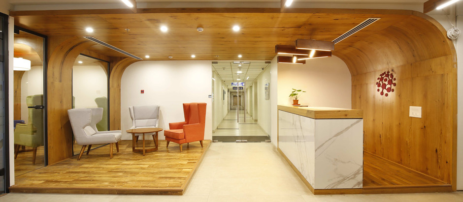 Warm, Inviting Interiors Meet Comfort & Luxury for this Office in Hyderabad