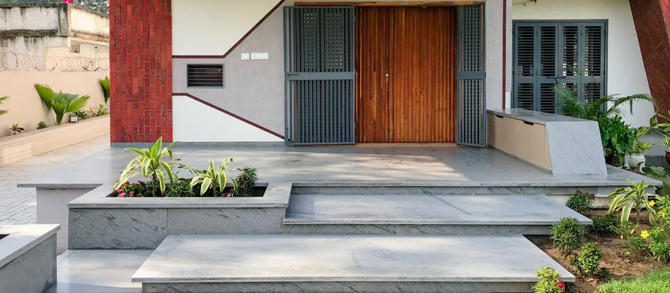 Visually Striking Brick Cladding Transforms Exterior Surfaces of this House into Dynamic Facades