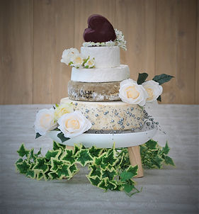 Cheese wedding cake with heart, flowers and Ivy