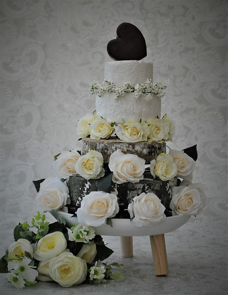 Cheese Wedding Cake with White Roses and a Heart