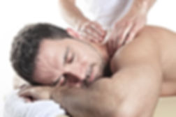 Man receiving Shiatsu massage from a pro