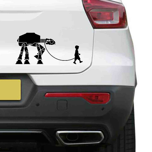 A vinyl decal showing an Star Wars AT-AT being walked like a dog on a rear car boot