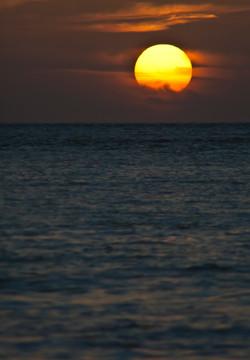Burning Sun Over the Cool Ocean