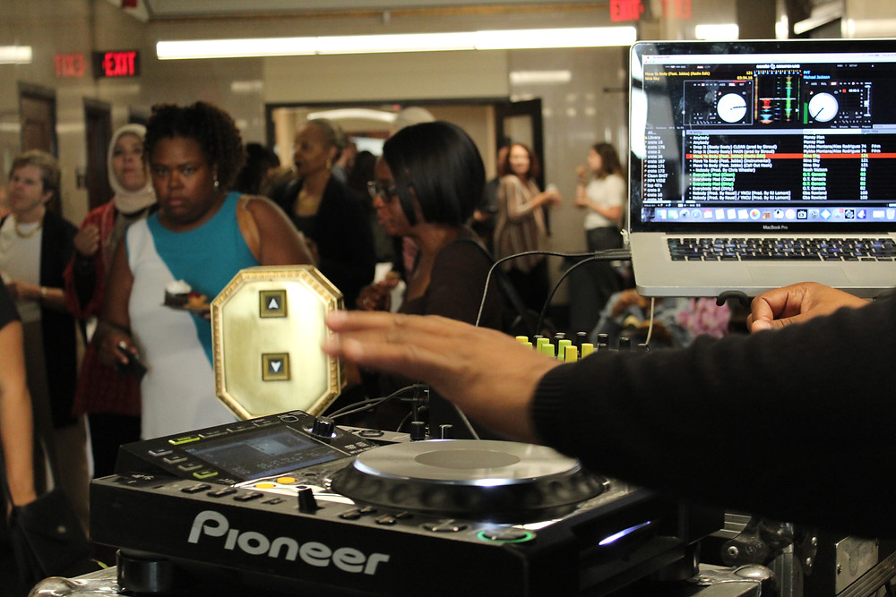 DJ spins as crowds pour out of the elevator at Kahn's headquarters during Drinks X Design