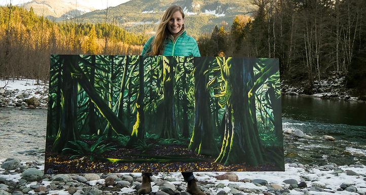 Squamish artist Jenna D. Robinson creating a landscape painting.