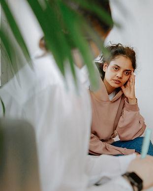 Canva - Woman Listening to Therapist.jpg