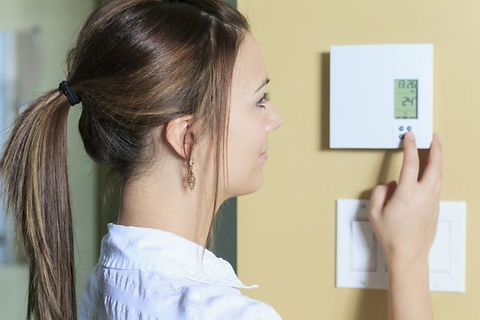 COST-woman-adjust-aircon-shutterstock_25