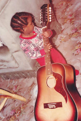 Little kizzy with the guitar