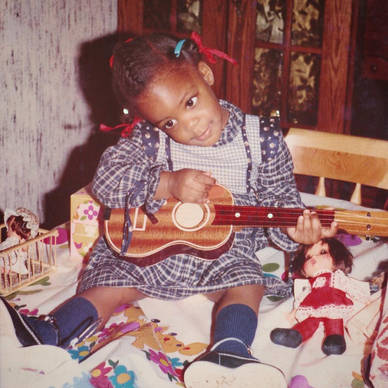 Little Kizzy with her guitar