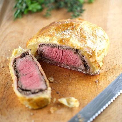 beef-wellington-sliced-on-cutting-board-