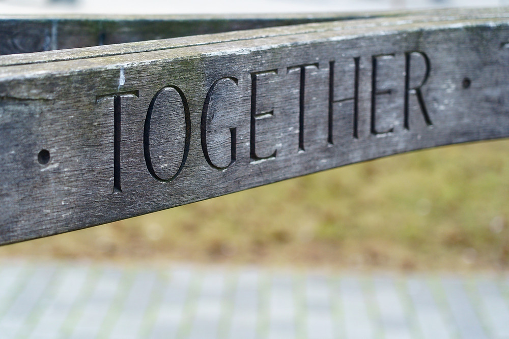 The word together to represent collaborating with other people