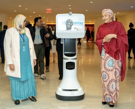 The UN Deputy Secretary-General Amina Mohammed and the UN-Habitat Executive Director Maimunah Mohd Sharif talk to youth in Nairobi via Ava Telepresence outside the Roundtable on Floating Cities in New York