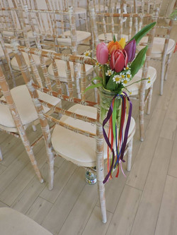 Tulip jars on ladder back chairs