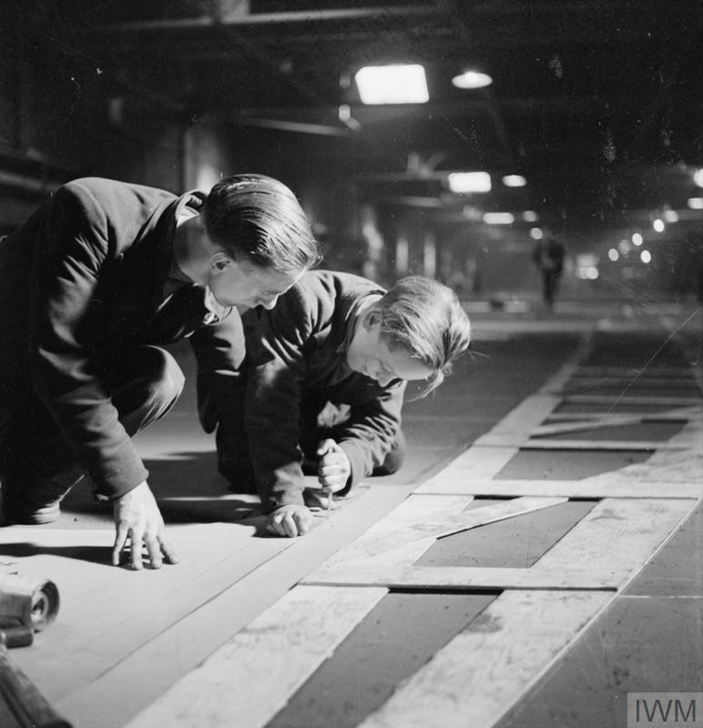 Two men cutting templates in the mould loft, Tyneside Shipyards, 1943
