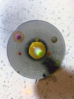 Spinning Solar System Top