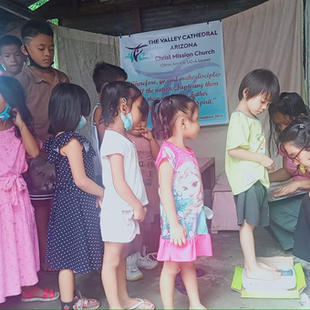Leaders of TVC-Mission Church in Towerville , SJDM Bulacan,  monitor the physical and spiritual health of children.
