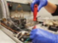 A man wearing gloves repairing a Gas Chr