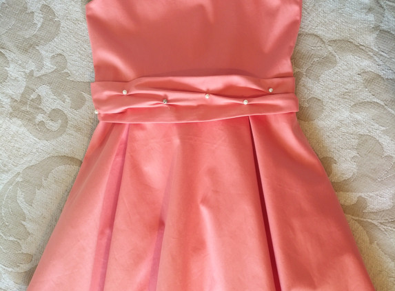 peach-dress-with-lace-details-on-shoulder-and-back