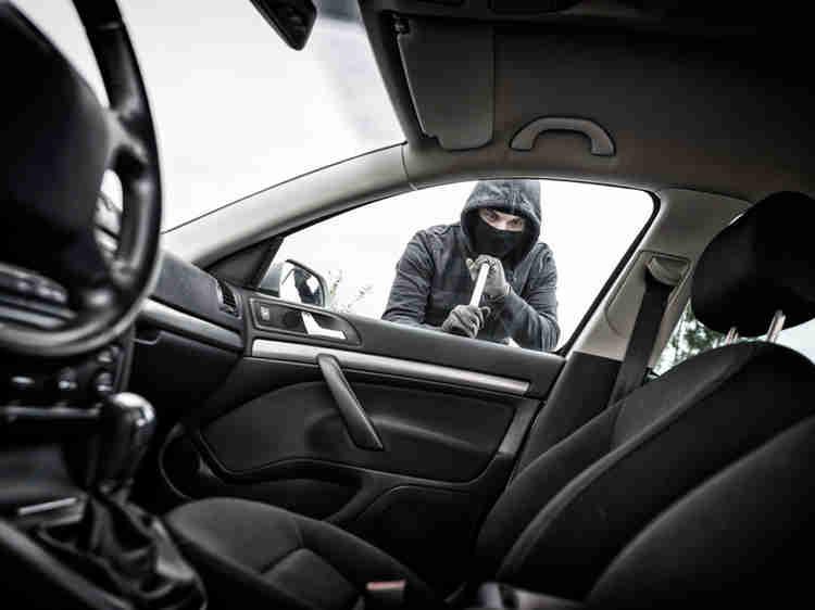 Man breaking into car