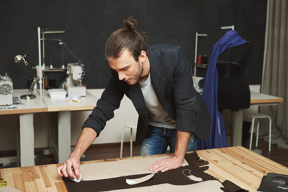bespoke_tailor_suit_cutting.jpg