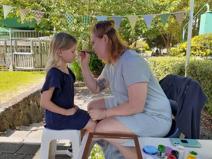 Face painting at Epsom Community Market