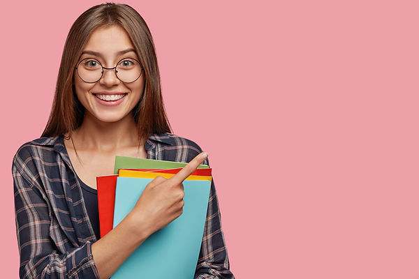 studio-shot-good-looking-young-businesswoman-posing-against-pink-wall-with-glasses.jpg