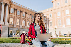 interested-dark-haired-girl-wears-casual-attire-chilling-park-near-university-using-laptop